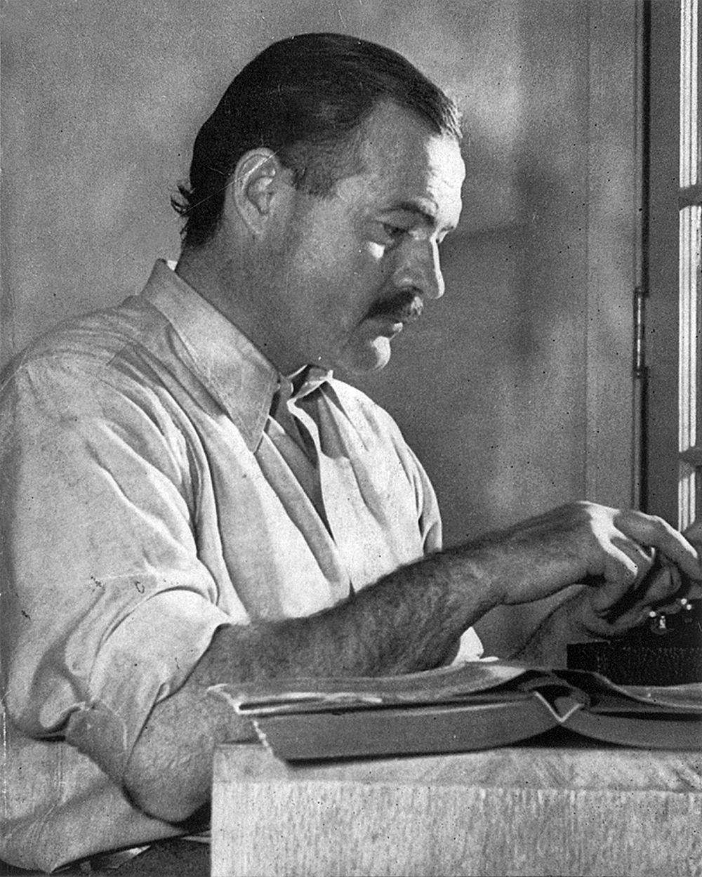 Ernest Hemingway working at his book For Whom the Bell Tolls at Sun Valley, Idaho in December 1939